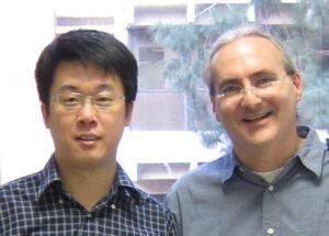 Lin Quan (left) and John Heidemann, after Lin's PhD defense.