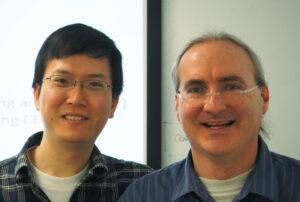 Xun Fan (left) and John Heidemann, after Xun's PhD defense.
